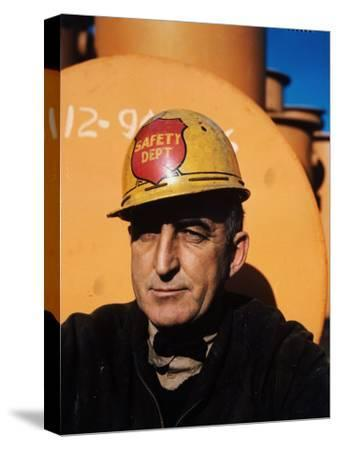Worker Wearing Safety Helmet Outside at Sun Shipbuilding and Dry Dock Co. Shipyards