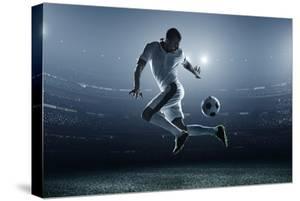 Soccer Player Kicking Ball in Stadium by Dmytro Aksonov