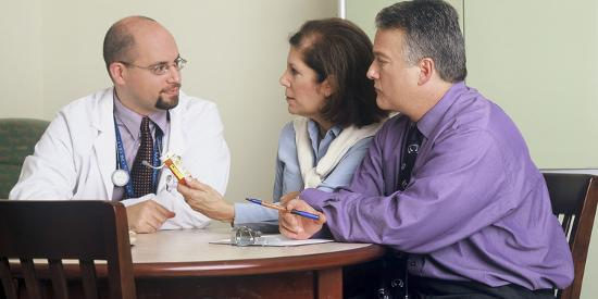 Doctor and Couple Seated around a Table Talking-Stocktrek Images-Photographic Print