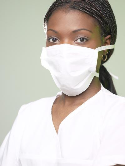 Doctor Wearing White Mask over Her Face--Photographic Print