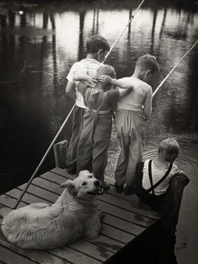 Dogs Supervising Fishing Boys--Photographic Print