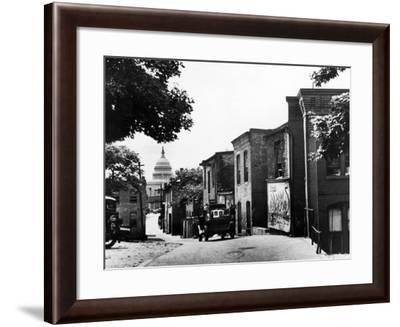 Dome of the Capitol Building Seen from Street in Neighboring Slum-Carl Mydans-Framed Photographic Print