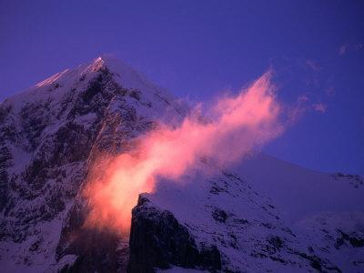 Eiger Mountain Looms in Purple Sunrise Light with Streaking Ridge Clouds, Bern, Switzerland