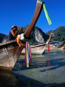 Fisherman on Longtail Boat About to Depart from Ao Ton Sai Beach, Ko Phi-Phi Don, Krabi, Thailand by Dominic Bonuccelli