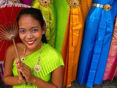 Girl Selling Dresses and Costume Materials Outside Temple of Dawn, Bangkok, Bangkok, Thailand