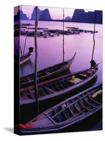 Longtail Boats Bob against Mooring Sticks at Sunset, Ko Panyi, Phang-Nga, Thailand