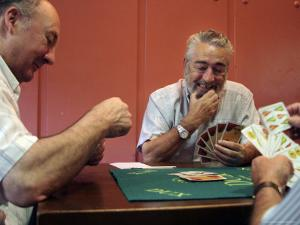 Old Men Playing Traditional Card Game in Bar Next to Fuente De Santa Cecilia by Dominic Bonuccelli