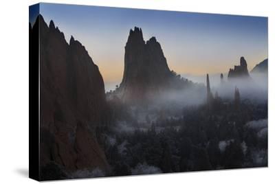 Colorado, Colorado Springs. Morning Fog in Garden of the Gods Park