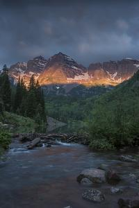 Colorado, Maroon Bells SP. Sunrise Storm Clouds on Maroon Bells Mts by Don Grall