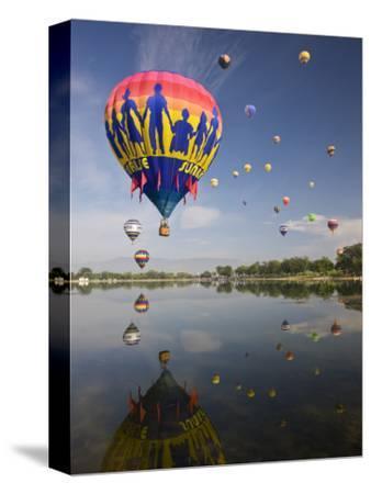 Hot Air Balloons Reflected in Prospect Lake, Colorado Springs, Colorado, USA