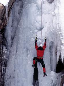 Ice Climber Ascending Wall by Don Grall