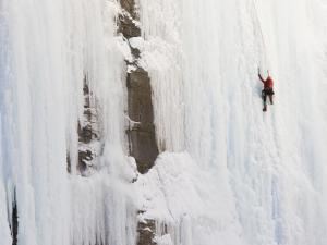 Ice Climber on Weeping Wall Above the Icefields Parkway, Banff National Park, Alberta, Canada by Don Grall