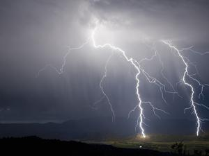Lightning Bolts Strike the Ground in the Upper Arkansas Valley of Colorado, USA by Don Grall