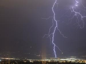 Lightning in Colorado Springs, Colorado, Usa During a Summer Thunderstorm by Don Grall