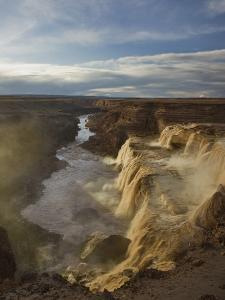 The Spring Melt Flows over Grand Falls on the Little Colorado River by Don Grall