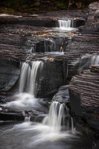 USA, Michigan, Upper Peninsula. Waterfalls in the Presque Isle River by Don Grall