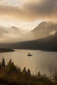 USA, Montana, Glacier NP. Sunrise pierces clouds over St. Mary Lake. by Don Grall