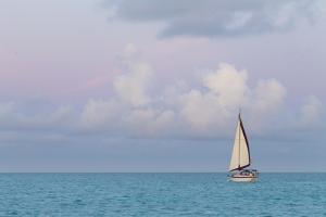 Bahamas, Exuma Island. Sailboat at Sunset by Don Paulson