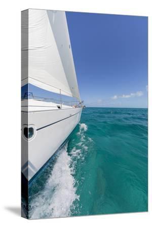 Bahamas, Exuma Island. Sailboat under Sail in Ocean
