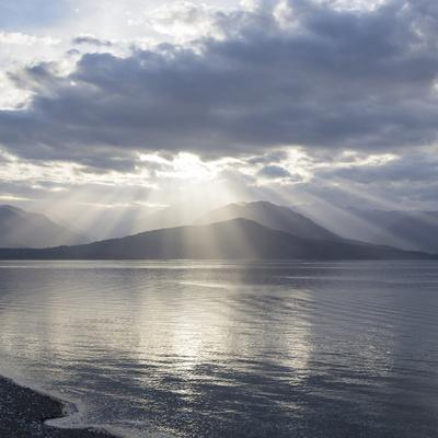 Washington State, Seabeck. Composite of God Rays over Hood Canal