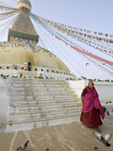 Buddhist Monk Descends the Steps of Boudha, the Tibetan Stupa in Kathmandu, Nepal by Don Smith