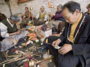 Carrying out Routine Maintenance of Prayer Wheels on a Monastery Roof, Lhasa, Tibet, China by Don Smith