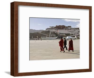 Monks Carrying Umbrellas to Shield Against the Sun, in Front of the Potala Palace, Tibet