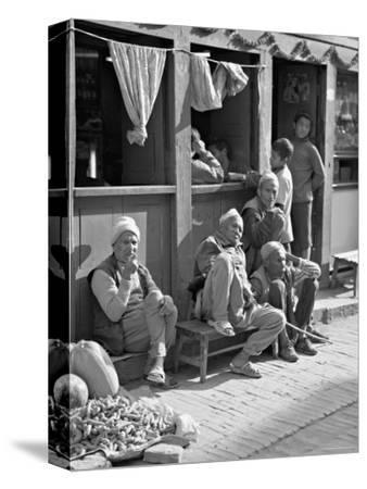 Old Men and Boys Outside a Cafe, Bhaktapur, Kathmandu Valley, Nepal