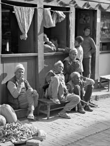 Old Men and Boys Outside a Cafe, Bhaktapur, Kathmandu Valley, Nepal by Don Smith