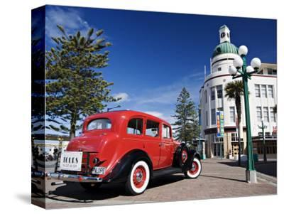 Old Red Car Advertising Tours in the Art Deco City, Napier, New Zealand
