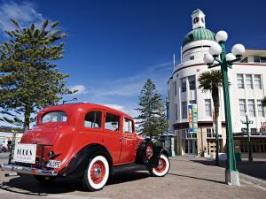 Old Red Car Advertising Tours in the Art Deco City, Napier, New Zealand by Don Smith