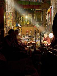 Shaft of Light Falls on Tibetan Buddhist Monks, Meru Nyingba Monastery, Bharkor, Tibet, China by Don Smith