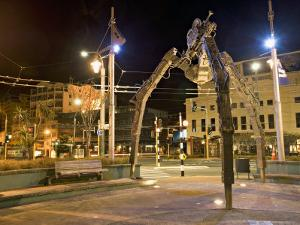 Tripod and Movie Camera Sculpture, at Night, Reflecting the Growing Film Industry, in Wellington by Don Smith