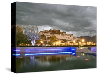 Water Feature in Front of the Potala Square Lit up with Neon Blue Lights in Early Evening, China