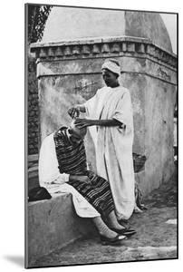 A Street Barber and His Client, Algeria, Africa, 1922 by Donald Mcleish