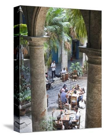 People at Tables and Musicians Playing in Courtyard of Colonial Building Built in 1780, Havana