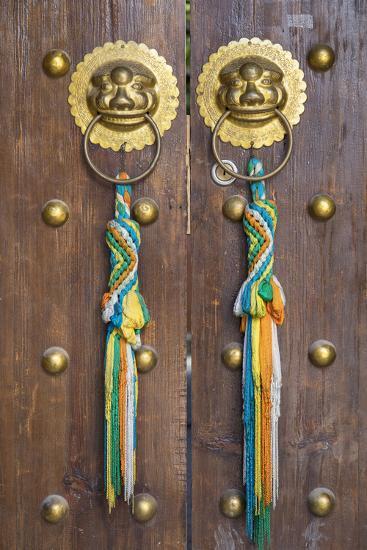 Door of guesthouse, Lijiang (UNESCO World Heritage Site), Yunnan, China-Ian Trower-Photographic Print