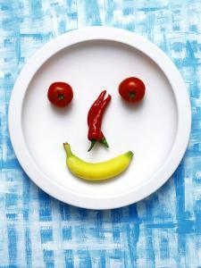 Food Collage: Face Made from Banana, Chili & Tomatoes on Plate by Dorota & Bogdan Bialy