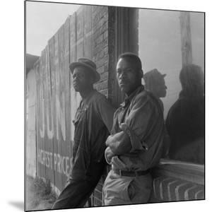African American seasonal cotton workers hoping to be hired for a day, 1938 by Dorothea Lange