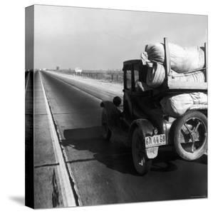 Car Laden with Baggage on Desolate Track of Highway in Desert in Southern California by Dorothea Lange