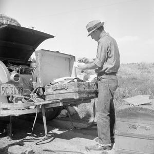 Car trouble on Highway 33, 1938 by Dorothea Lange