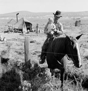Cowboy Holds His Baby While Riding a Horse by Dorothea Lange