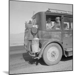 Farm family drive away from the Dust Bowl, 1936 by Dorothea Lange