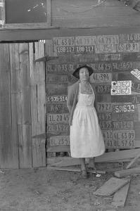 Farm Woman Beside Her Barn Door by Dorothea Lange