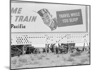 Highway billboard, 1938 by Dorothea Lange