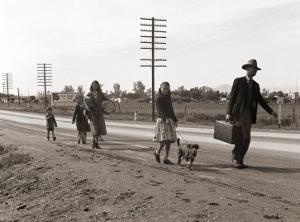 Homeless Migrant Family of Seven, Walking the Highway from Phoenix, Arizona, 1939 by Dorothea Lange