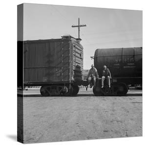 Itinerant men on oil tank cars passing through California, 1938 by Dorothea Lange