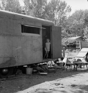 Little Girl in Hous Trailer by Dorothea Lange