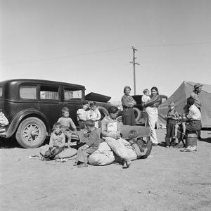 Migrating families camp by the road on their way to California, 1937 by Dorothea Lange