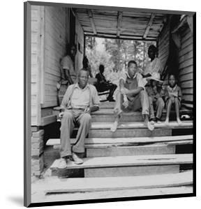 Negro Family Sharecroppers on Porch by Dorothea Lange
